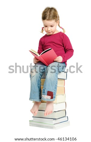 Full isolated studio picture from a young child sitting on some books