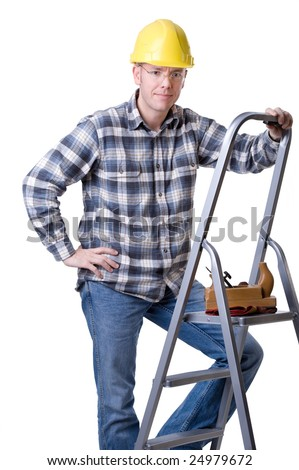 Full isolated studio picture from a young craftsman on a ladder - stock photo