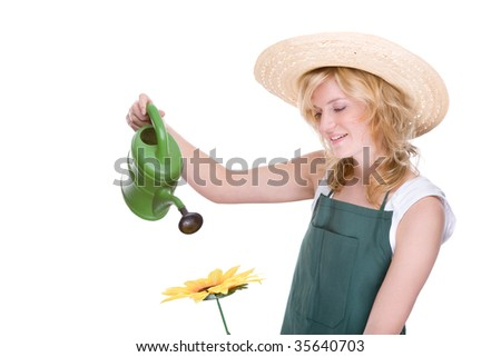 Full isolated studio picture from a young gardener at work - stock photo