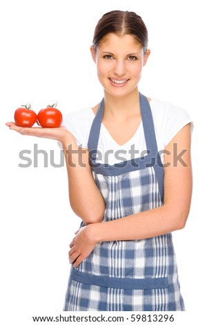 Full isolated studio picture from a young housewife in the kitchen