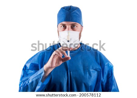 Full isolated studio picture from a young male doctor with syringe in his hand.
