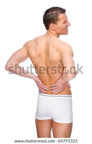 Full isolated studio picture from a young naked man with backache