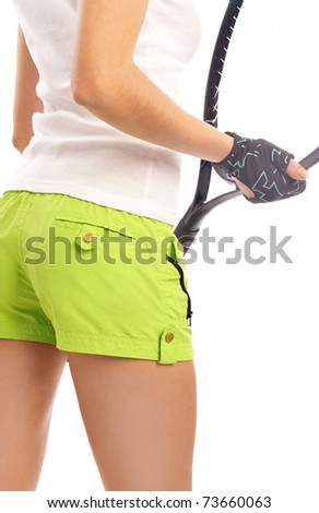Full isolated studio picture of a young woman with tennis racket - stock photo