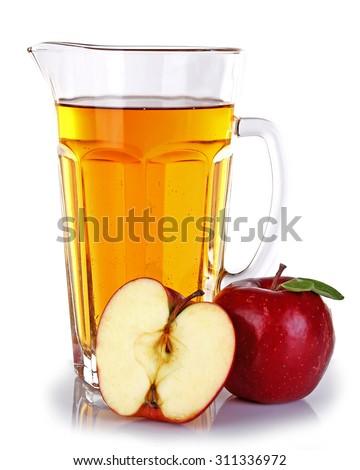 Full jug of apple juice and fruit isolated on white - stock photo
