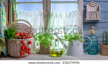 Full kitchen with fresh spring vegetables - stock photo