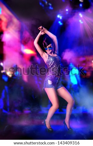 Full lenght portrait of dancing girl at the night club - stock photo