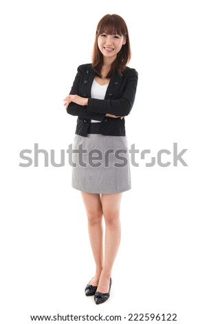 Full length Asian businesswoman standing isolated on white background.