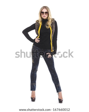 Full length attractive young girl in sunglasses posing - stock photo