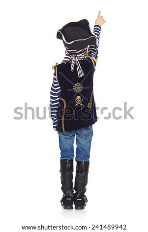 Full length back view of little boy wearing pirate costume standing over white background and pointing up - stock photo
