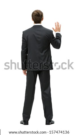 Full-length backview of businessman waving hand, isolated on white. Concept of leadership and success - stock photo