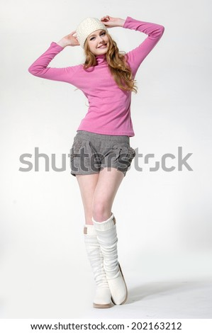 Full length beautiful girl wearing a white beret in white boots - stock photo
