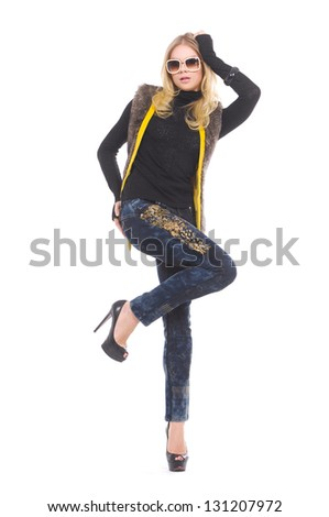 full-length beautiful young woman in sunglasses posing - stock photo