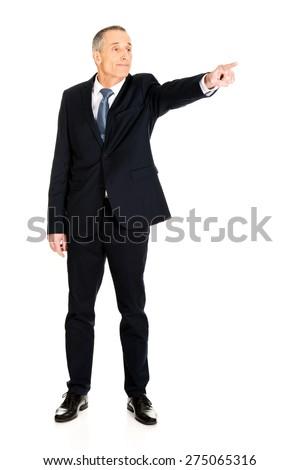 Full length boss dismissing someone. - stock photo