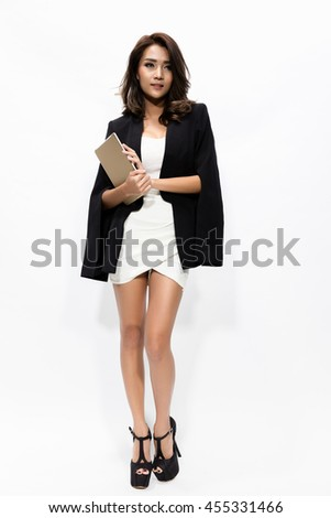 full length business woman holding touch pad tablet pc isolated on white background, model is a asian beautiful - stock photo