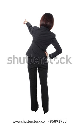 full length Business woman points finger at something in her back. Isolated on white background, model is a asian beauty - stock photo