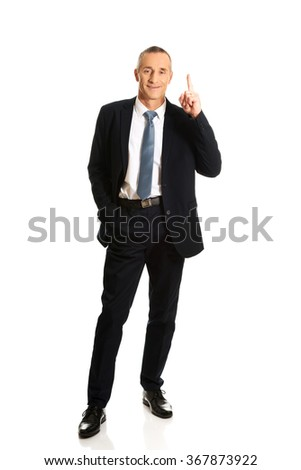 Full length businessman pointing upwards  - stock photo