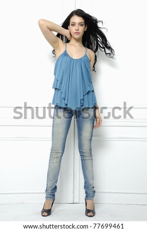 Full length casual picture of young sexy woman in blue jeans - stock photo
