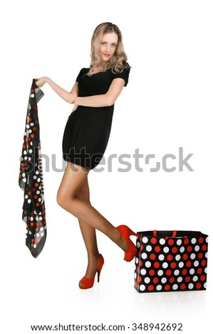 Full length casual young fashionable woman with a bag on white background