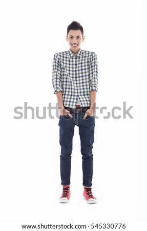 Full length casual young man in jeans posing on white background