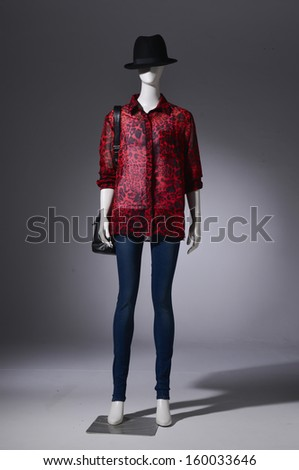 Full length Fashion female clothing in hat with bag on mannequin in light background - stock photo