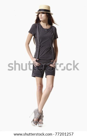 Full length fashionable woman in a hat posing - stock photo