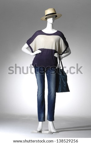 full-length female clothing in jeans with bag on mannequin - stock photo