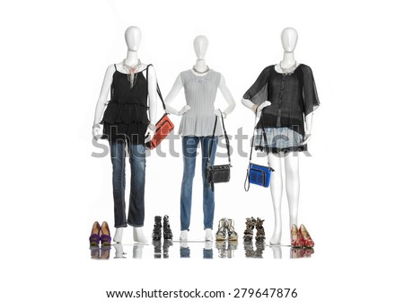 full-length female clothing with jeans ,boots on three mannequin  - stock photo