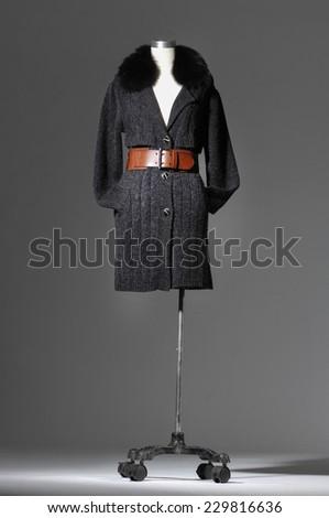 Full length female coat clothing on mannequin   - stock photo