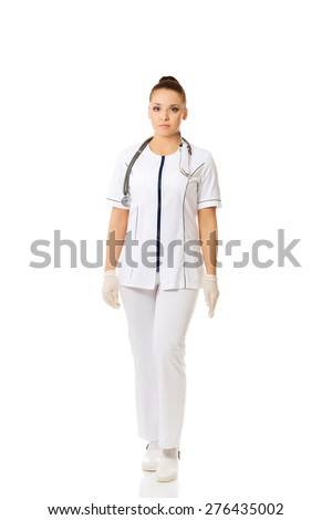 Full length female doctor standing. - stock photo