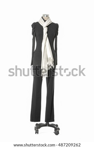 full-length female dress with white scarf and trousers isolated on a dummy