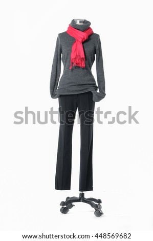 full-length female elegant dress with red scarf and trousers on n mannequin    - stock photo