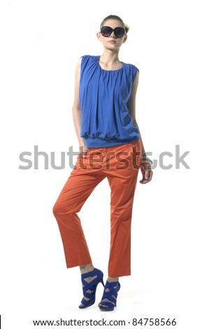 Full length female fashion model posing against white background - stock photo