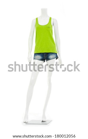 full-length female mannequin in trousers, jeans shorts and green shirt  - stock photo