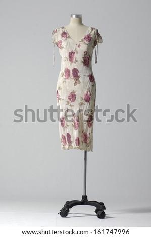 full length female sundress on mannequin-gray background - stock photo