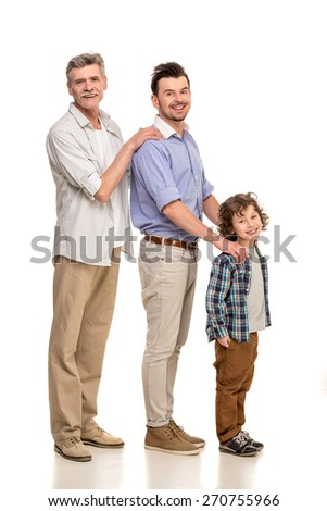 Full length. Generation portrait. Grandfather, father and son, isolated a white background. - stock photo