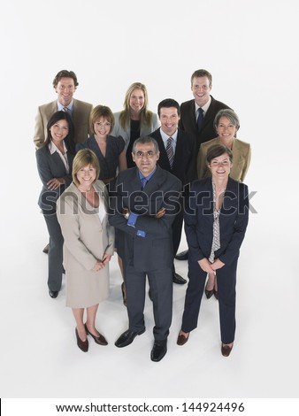 Full length group portrait of multiethnic businesspeople against white background - stock photo