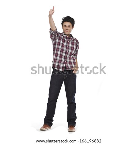 Full length happy smiling young Asian man show thumb isolated on white background - stock photo