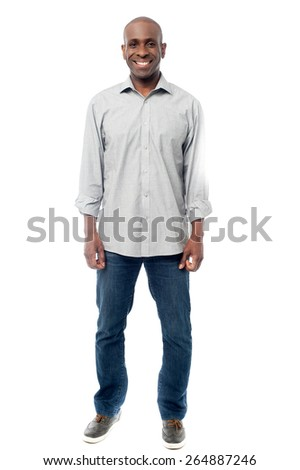 Full length image of a casual young man - stock photo