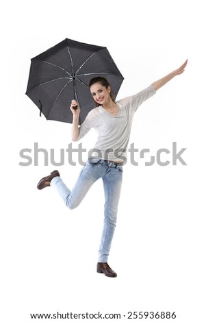 Full-length image of a Caucasian woman wearing casual clothes and standing under an umbrella. Isolated on White Background. - stock photo