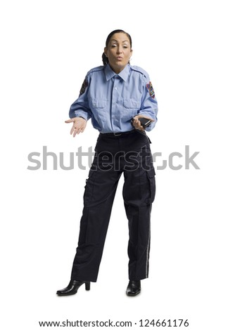 Full length image of a policewoman shrugging her shoulder - stock photo