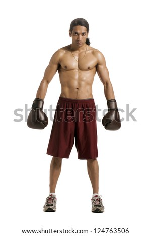 Full length image of an Asian boxer standing alone in a white background