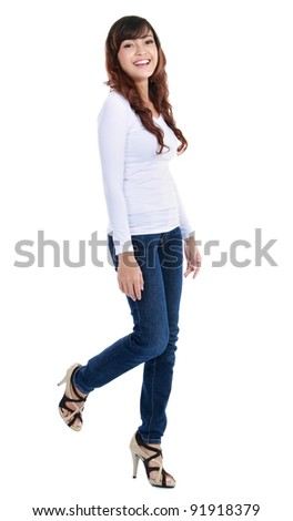 Full length image of an attractive young girl walking over white background - stock photo