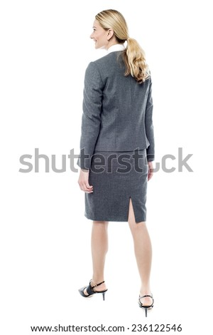 Full length image of business woman in motion - stock photo