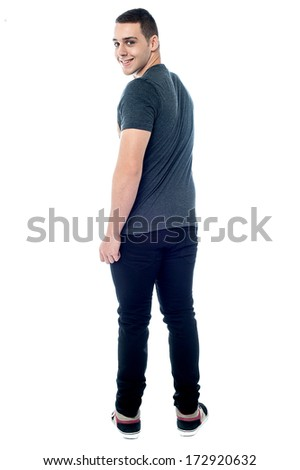 Full length image of smart young man turning back - stock photo