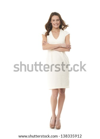 Full length image of successful young businesswoman with her arms folded on white background - stock photo