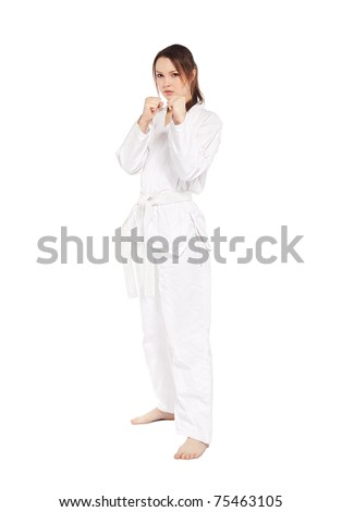 full-length isolated portrait of beautiful martial arts girl in kimono excercising karate kata - stock photo