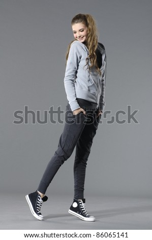 Full length lovely young leisure woman in cap posing - stock photo