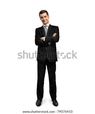 full length male businessman in suit with folded hands, looking on camera