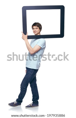 Full length man carrying tablet frame on his shoulder, over white background - stock photo