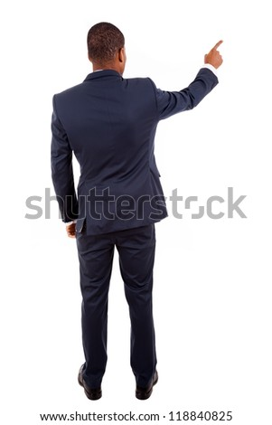 Full length of a African American business man pointing at something on white